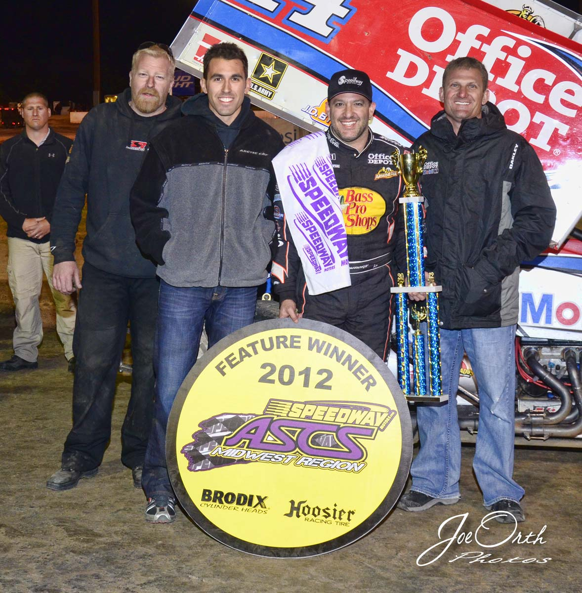 eagle-04-21-12-ascs-tony-stewart-with-aric-almirola-and-crew