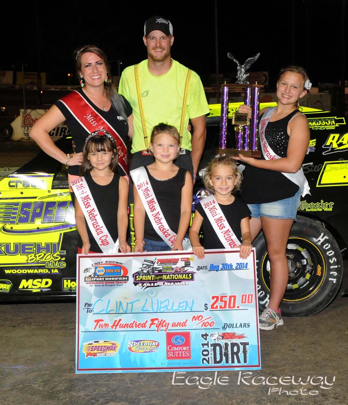 Eagle-08-30-14-448-Clint-Luellen-with-2013-Miss-Nebraska-Cup-Elle-Potocka-along-with-2014-Mini-Miss-Nebraska-Cup-finailist-and-flagman-Billy-Lloyd-JoeOrthPhoto