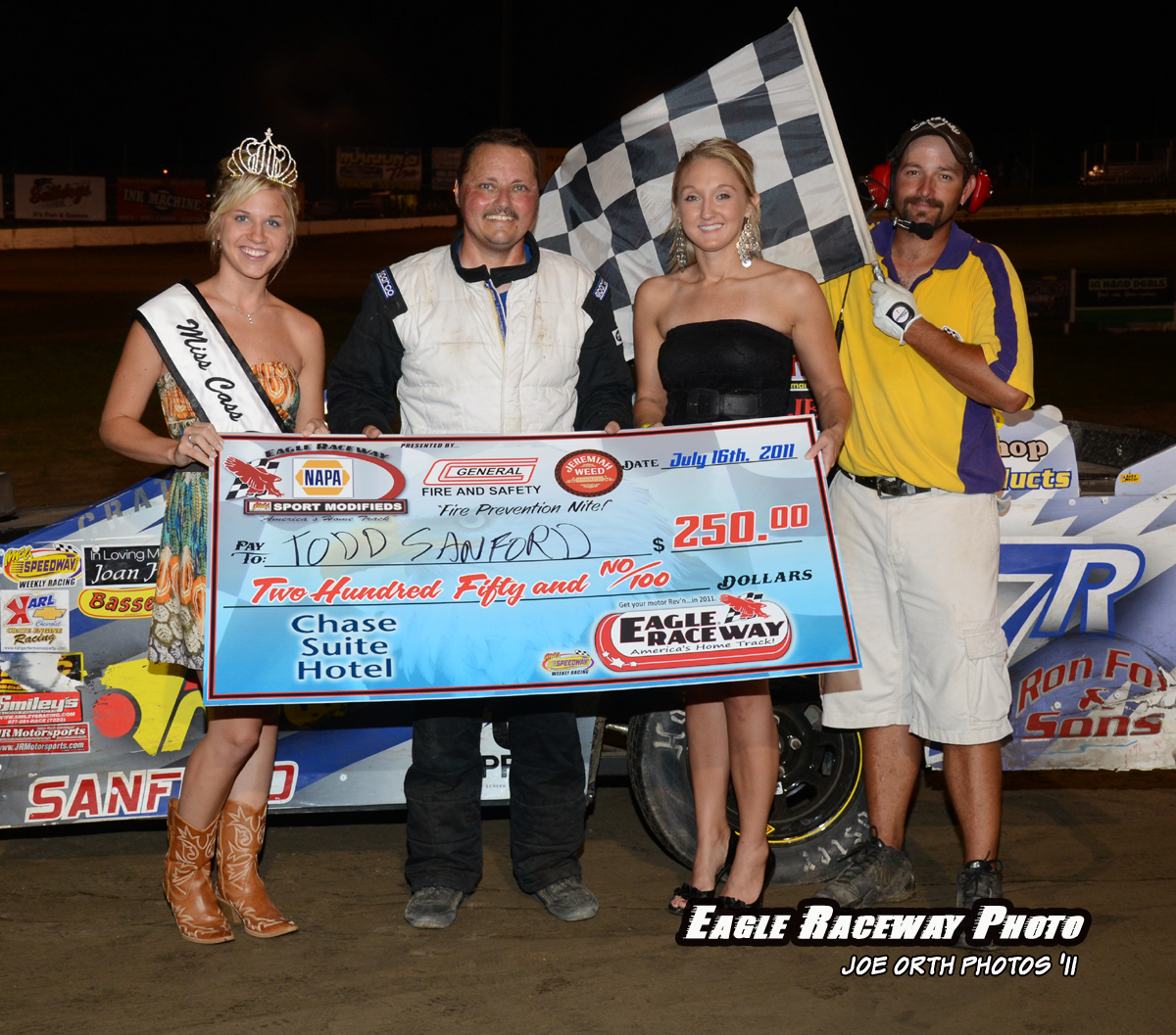 eagle-07-16-11-todd-sanford-with-miss-cass-county-deanne-kathol-and-2010-miss-nebraska-cup-finalist-jessica-spanel-and-flagman-billy-lloyd