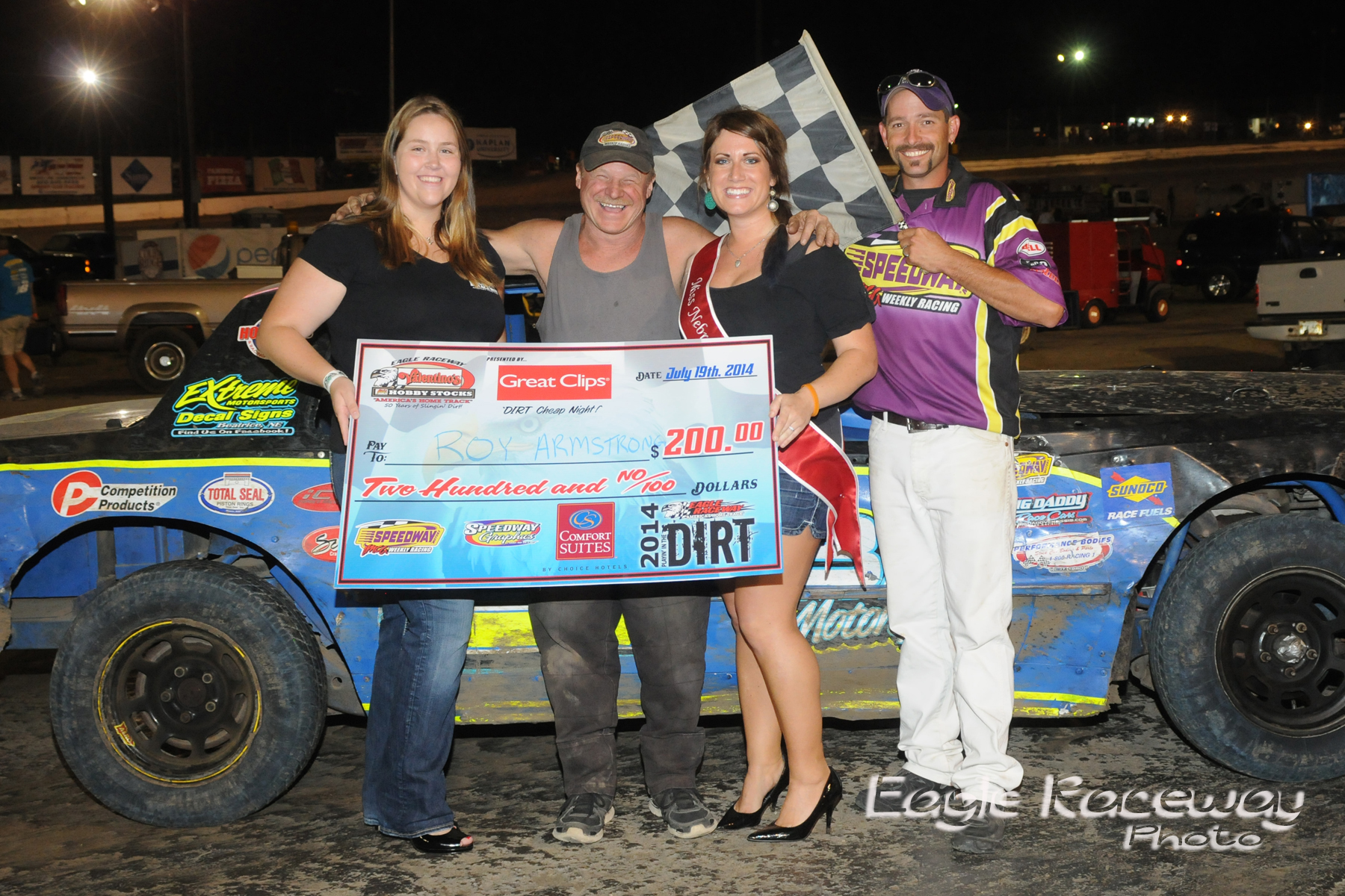eagle-07-19-14-418-roy-armstong-with-miss-nebraska-cup-elle-patocka-and-miss-nebraska-cup-finalist-donna-hafsaas-and-flagman-billy-lloyd-joeorthphotos