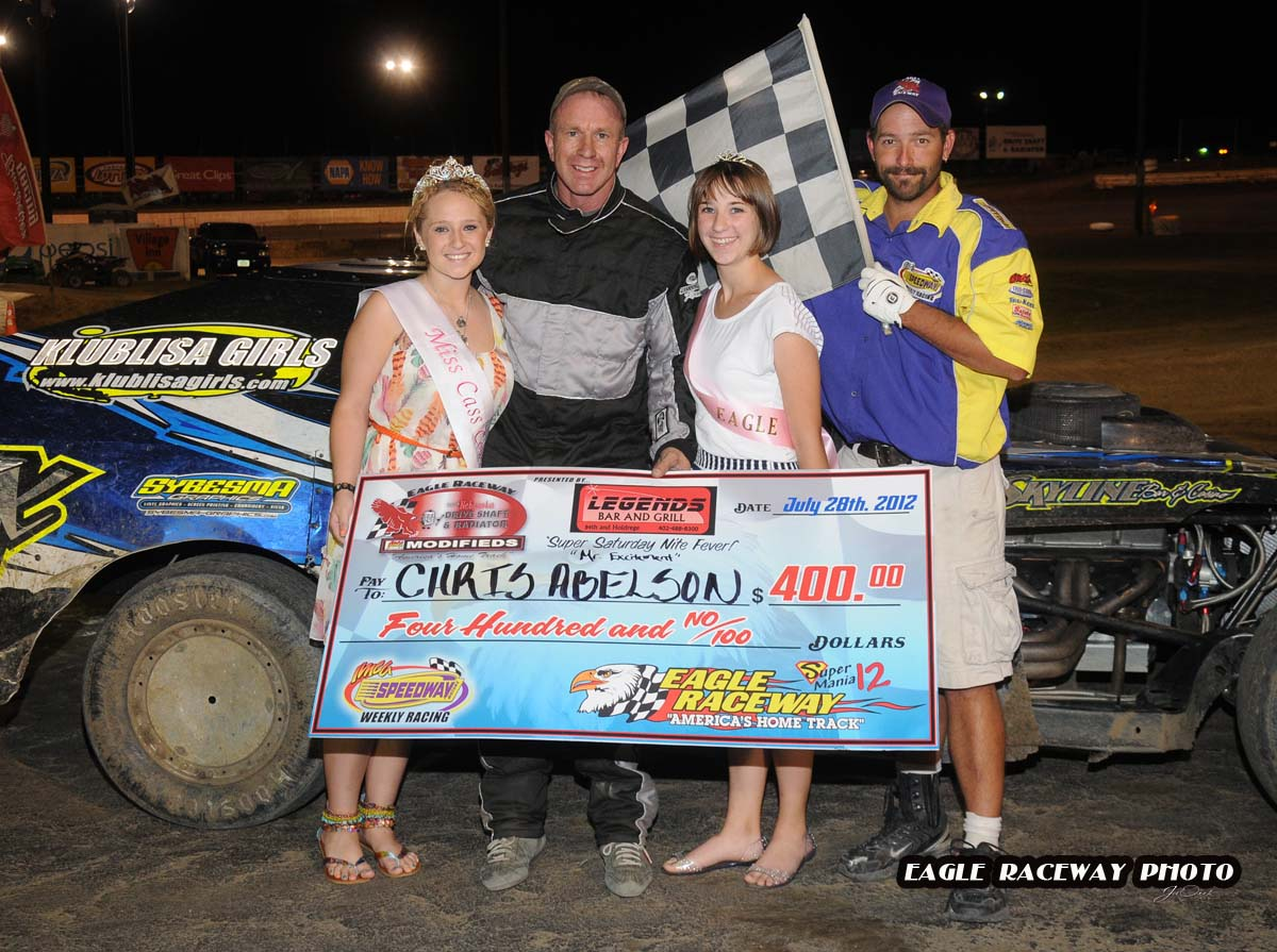 eagle-07-28-12-535-chris-alebson-with-miss-cass-county-loxley-grafe-and-miss-eagle-amanda-fogerty-and-flagman-billy-lloyd