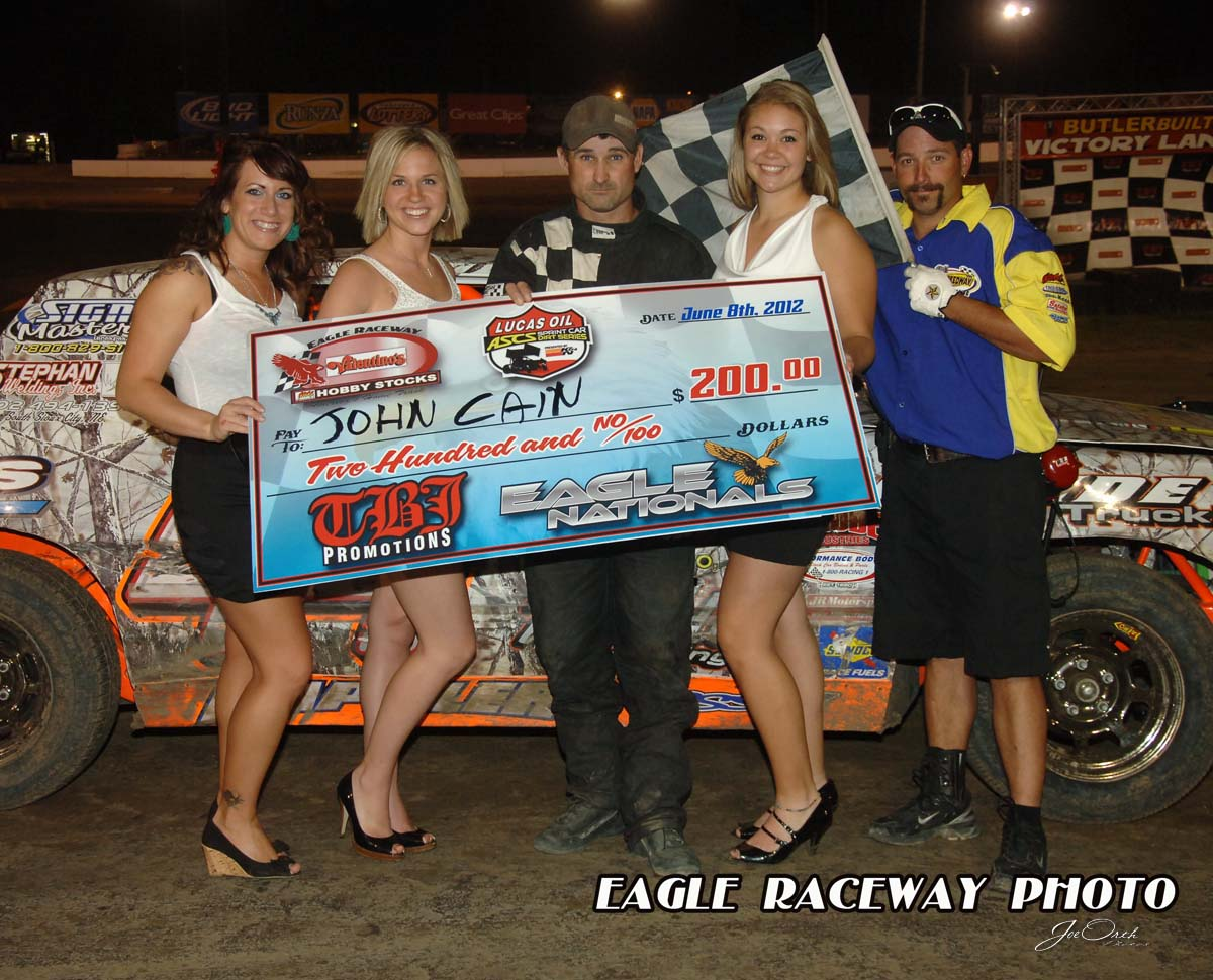 eagle-6-8-12-647-john-cain-with-miss-nebraska-cup-deanne-kathol-and-finalist-elle-patocka-and-lindsey-flodman-and-flagman-billy-lloyd