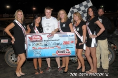 eagle-09-04-11-adam-armstrong-with-2011-nebraska-cup-finalist-catrina-harris-elle-patocka-emma-kelley-jamie-kromberg-lindsey-flodman-and-flagman-billy-lioyd