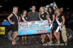 eagle-09-04-11-joey-danley-with-2011-nebraska-cup-finalist-catrina-harris-elle-patocka-emma-kelley-jamie-kromberg-lindsey-flodman-and-flagman-billy-lioyd