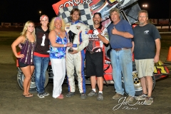 Eagle-09-05-15-IMCA-Nationals-553-John-Carney-II-and-crew-with-the-Jake-Ita-family-and-flagman-Billy-Lloyd-JoeorthPhotos-Copy