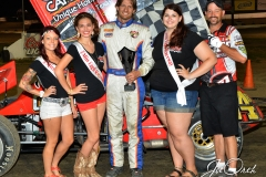 Eagle   09-05-15   IMCA Nationals 562       John Carney II with 2015 Miss Eagle Raceway finalist Kayla Meidinger Zoe Dalton Robin Brunison and flagman Billy Lloyd   Joeorth - Copy.JPG